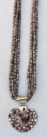 Strands of Penshell With White Buffalo Stone Pendant
